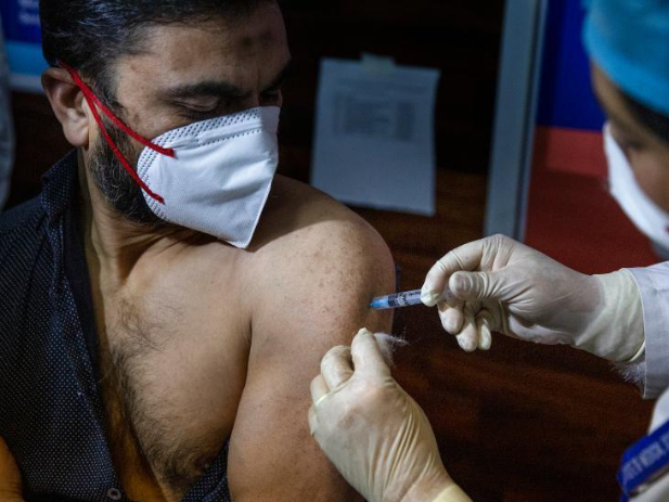 People receive COVID-19 vaccines in summer capital of Indian-controlled Kashmir