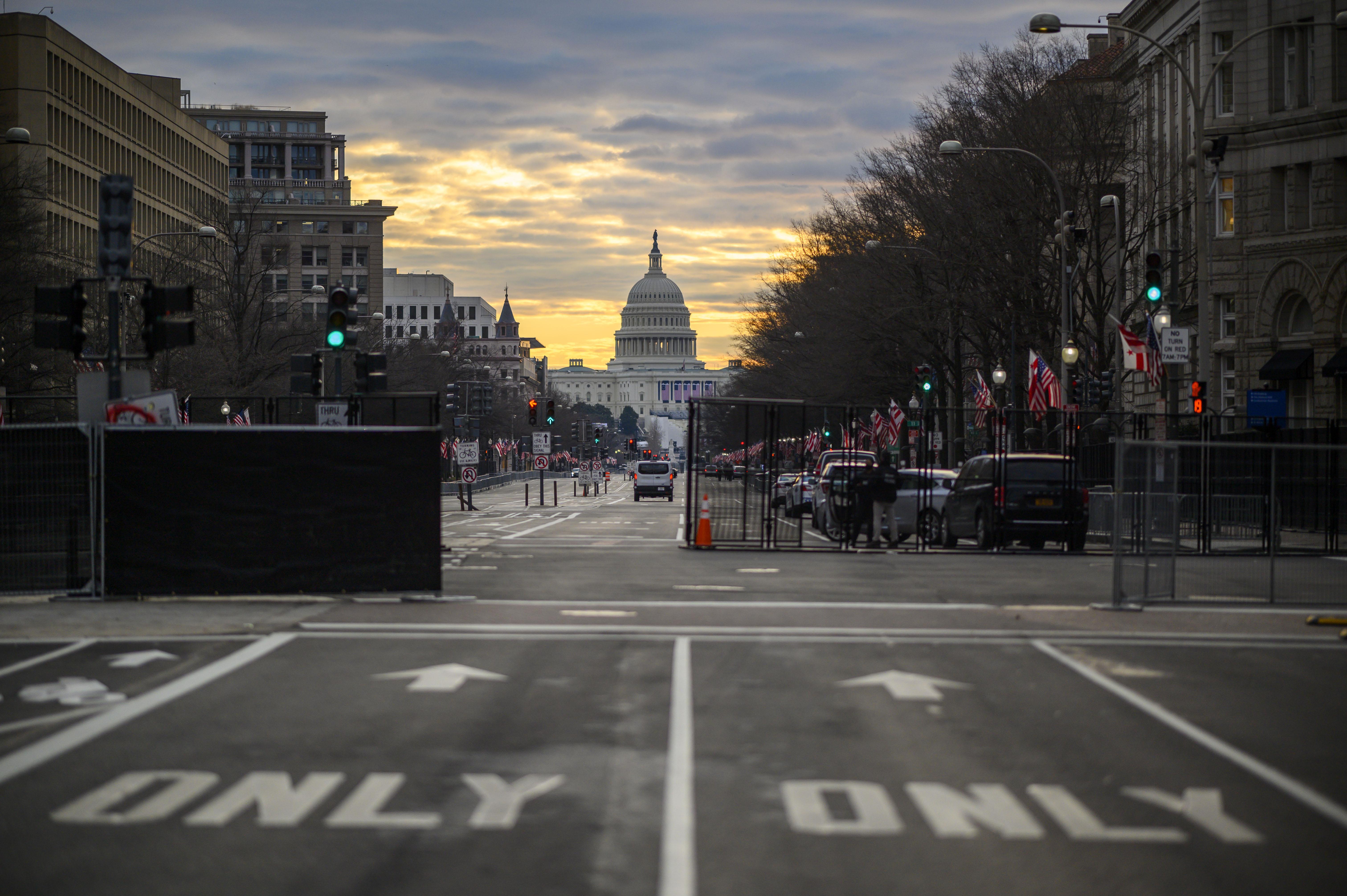 Biden team says US will not lift travel bans, despite Trump statement