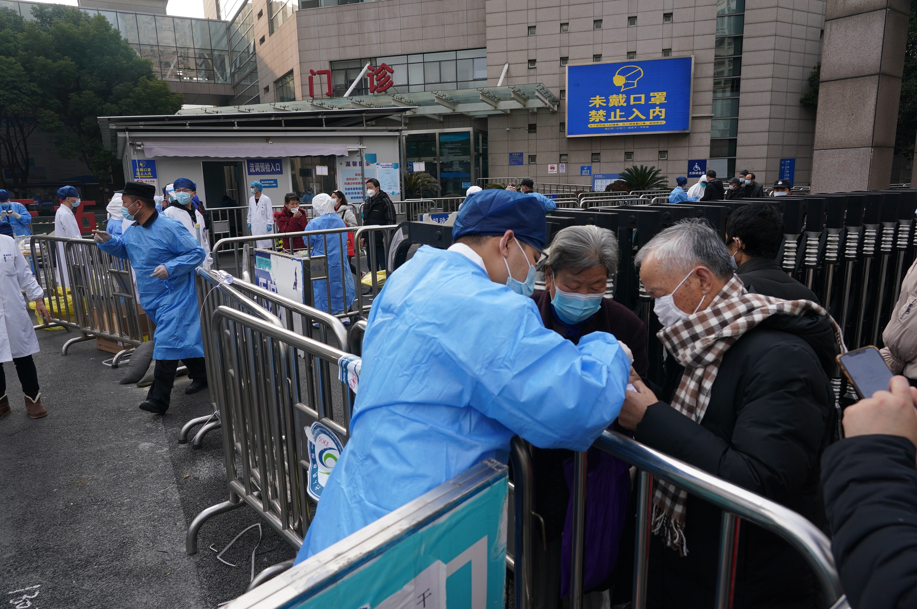 Two Shanghai hospitals suspend services after new cases reported