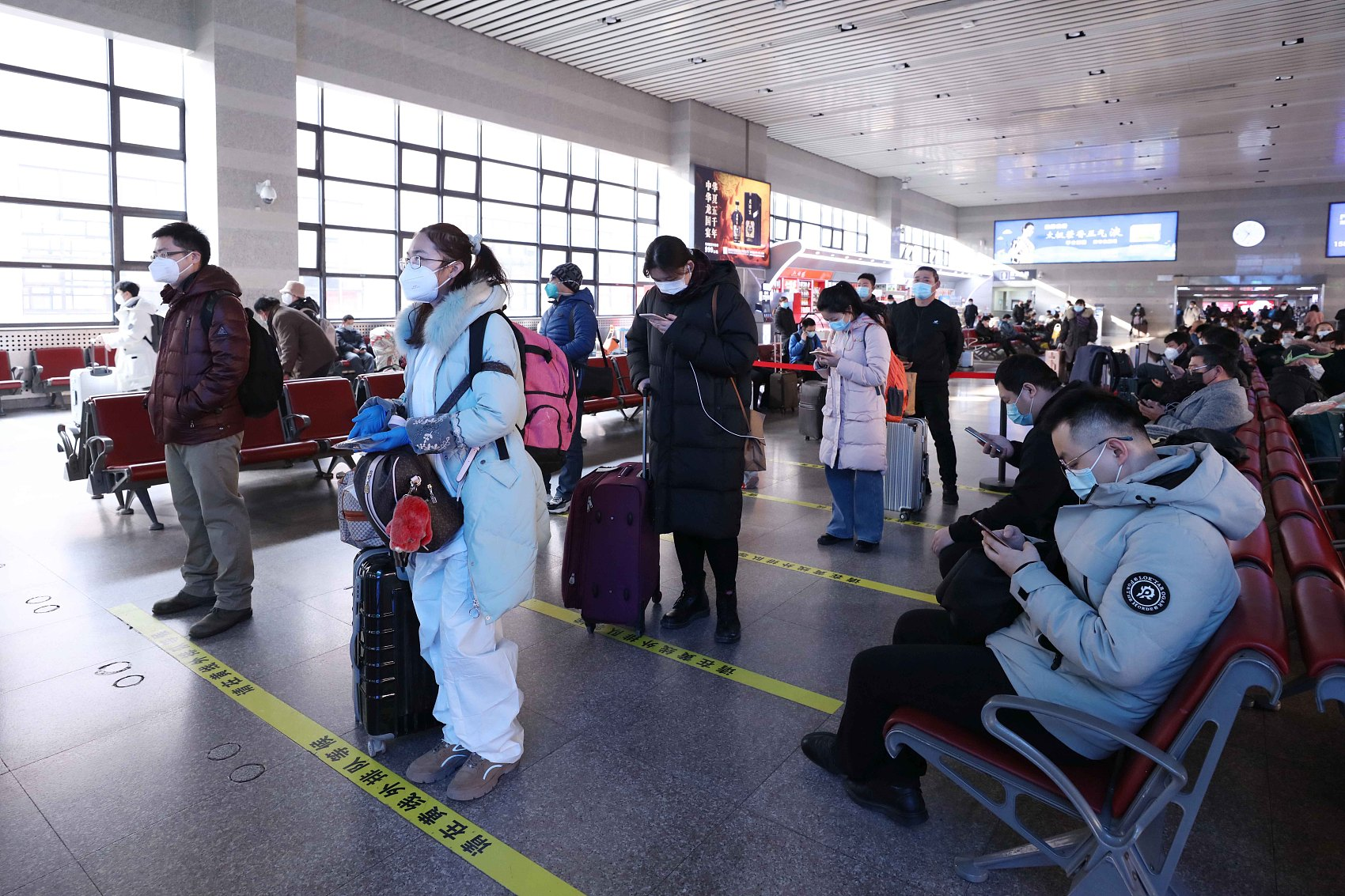 China beefs up COVID-19 containment for world's biggest annual human migration