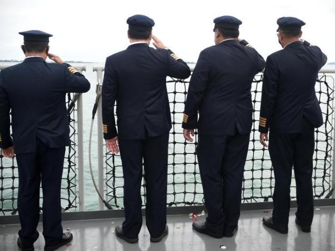 Sriwijaya Air crew members pay tribute to plane crash victims in Indonesia