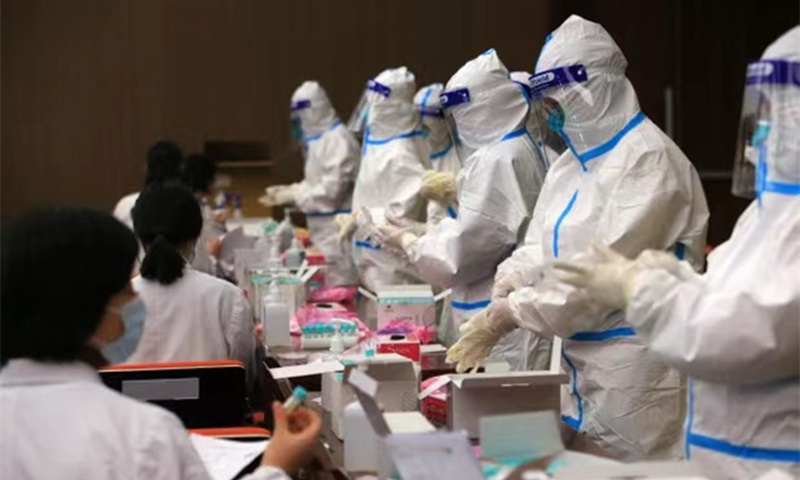 Shanghai COVID-19 patients working at hospitals 'hadn't been vaccinated'