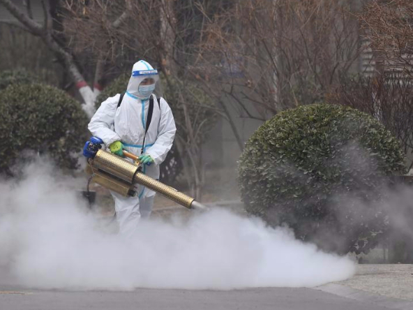 Staff members spray disinfectant at residential community to prevent spread of COVID-19 in Shijiazhuang