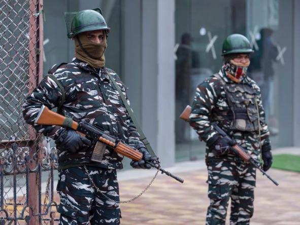 Indian paramilitary troopers stand guard near Shar-e-Kashmir stadium
