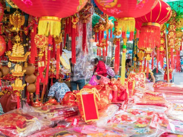 People buy spring couplets and other decorations for upcoming Chinese Lunar New Year in Bangkok