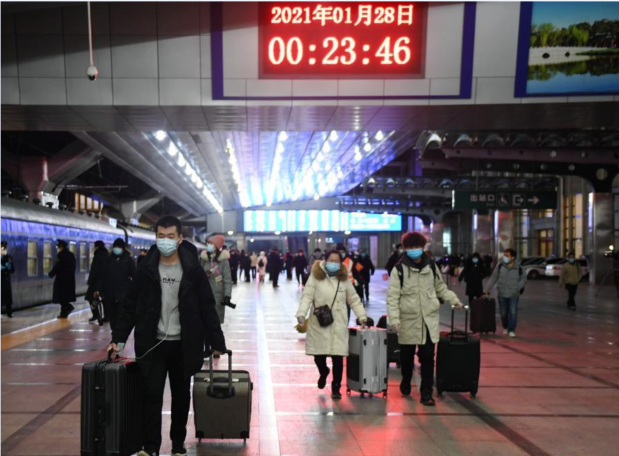China further lowers travel forecast for peak holiday