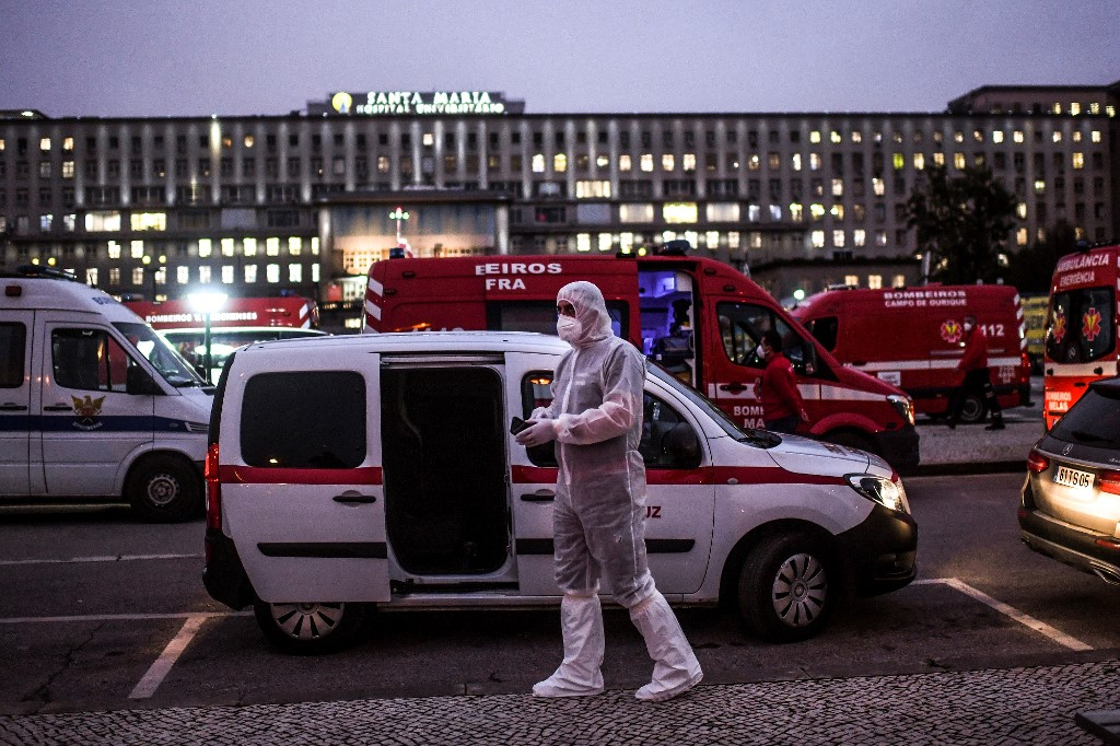 Portugal curbs travel after record virus deaths