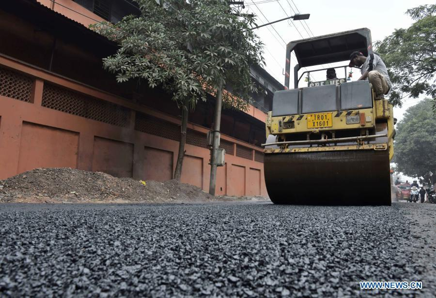 People use plastic waste to make road in Agartala, India