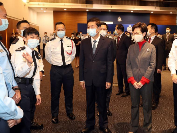 HKSAR chief executive, liaison office director greet police officers ahead of Chinese New Year