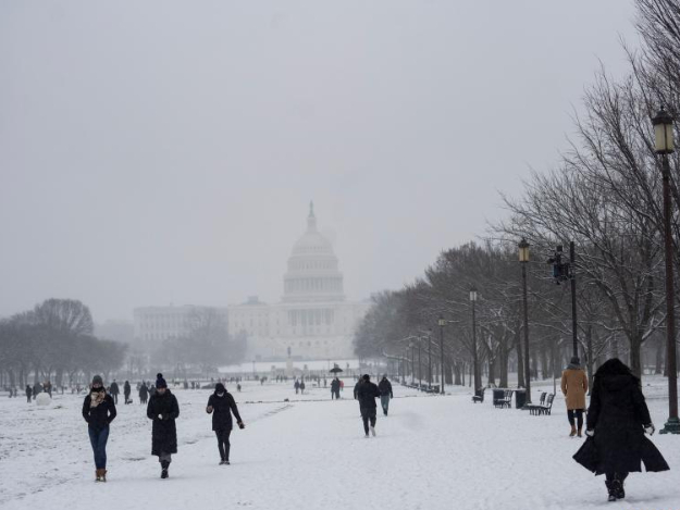 People play in snow in Washington DC