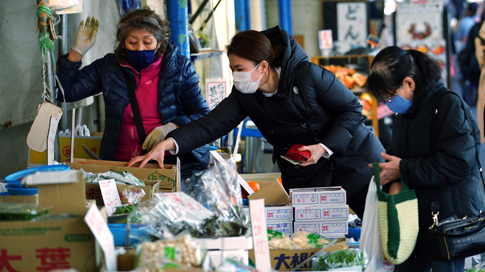 Japan to extend virus emergency to March 7: Report