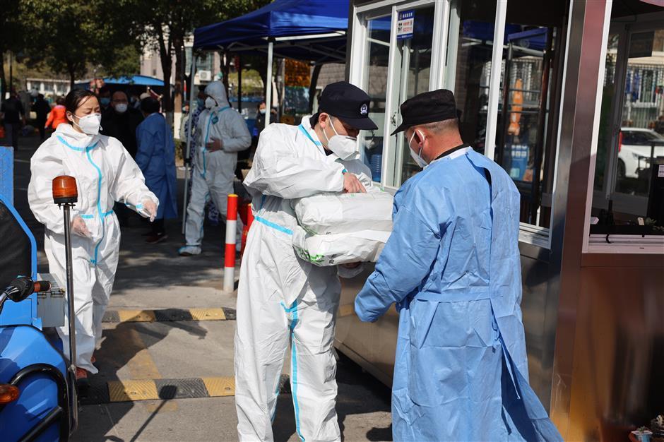 Parcel deliveries sorted in residential complex under lockdown