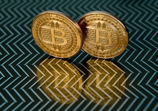 Dollar drops, as bitcoin nears $50,000