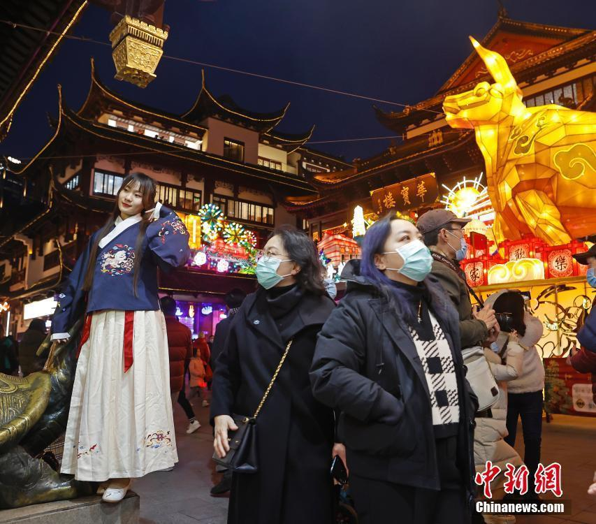 Visitors view lanterns at Yuyuan Garden in Shanghai