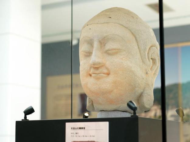 Stone Buddha head displayed in Beijing