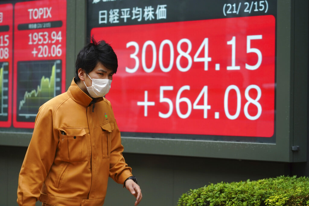 Japan's Nikkei closes above 30,000-level for 1st time in over 30 years