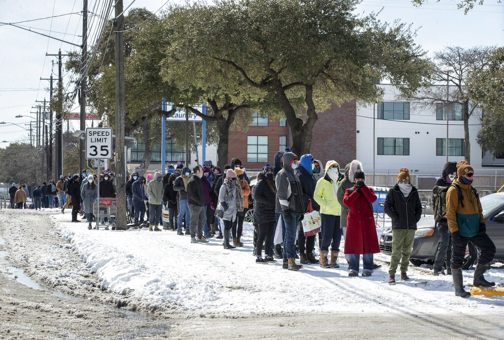 Millions endure record cold without power; at least 16 dead