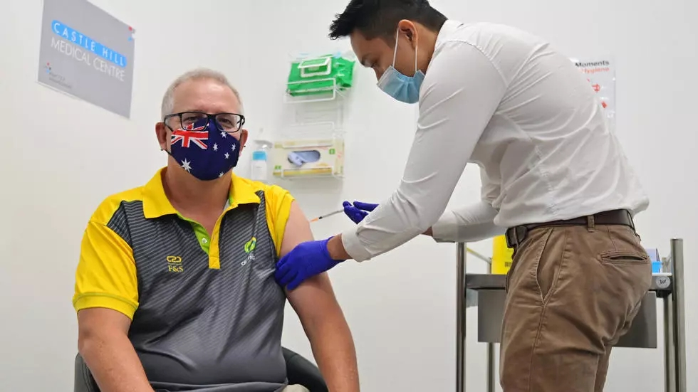 Australia administers first Covid-19 vaccines