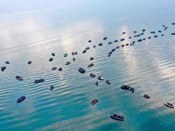 Fishermen fish on Dojran Lake in Dojran, North Macedonia