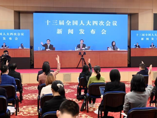 China's top legislature has power, responsibility to improve HK electoral system: spokesperson