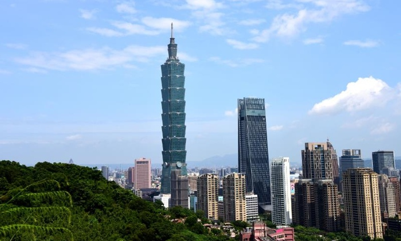 Changes in govt work report on Taiwan show tougher line for 'national reunification'