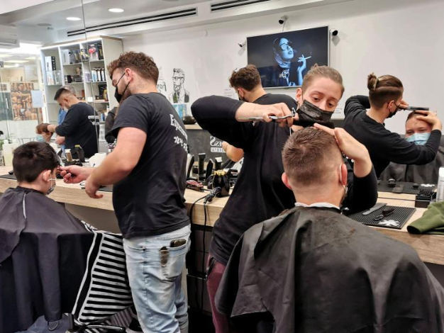 Israeli barbers work in reopened barber shop in central Israeli city of Modiin