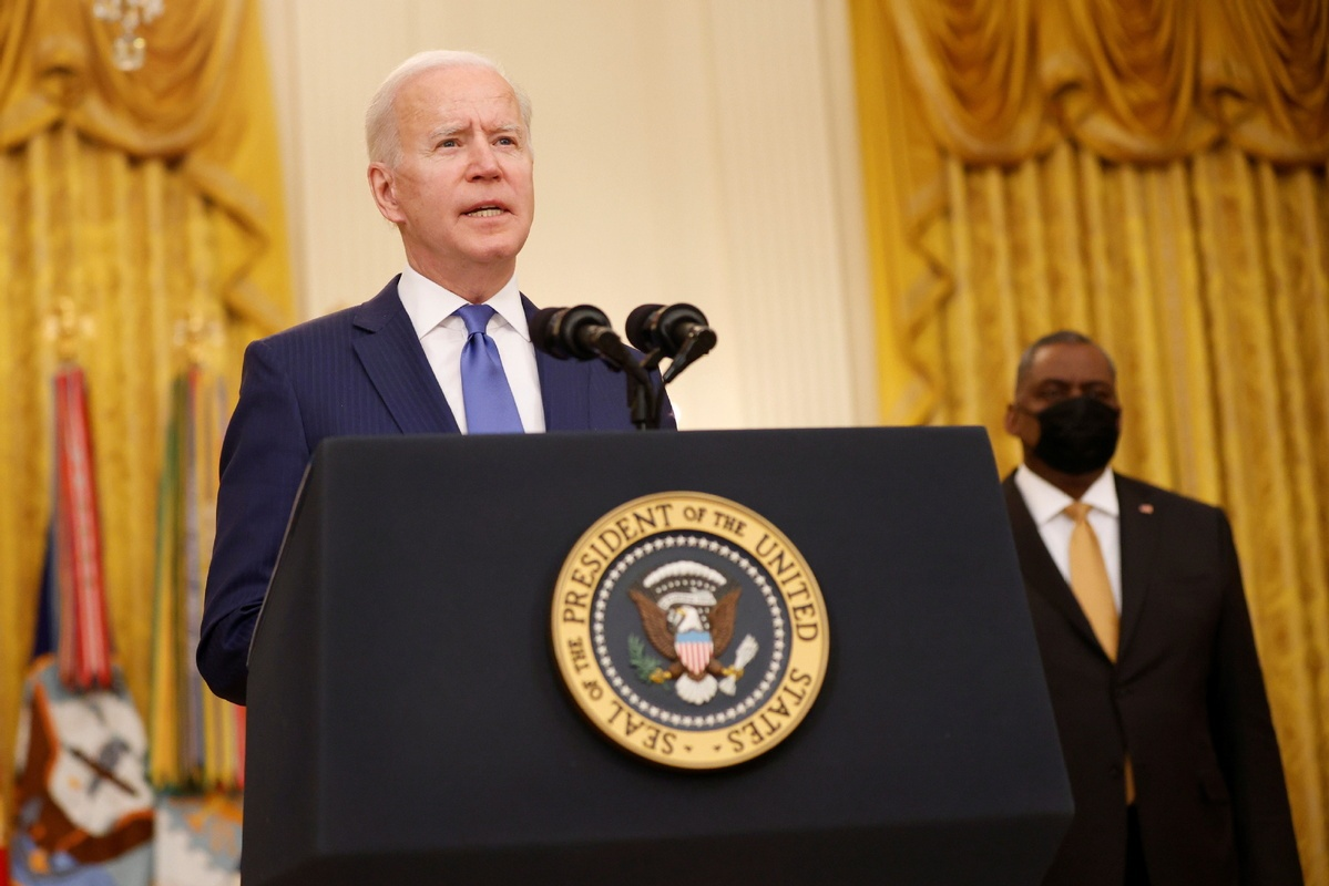 Biden signs executive orders on gender equity to mark Intl Women's Day