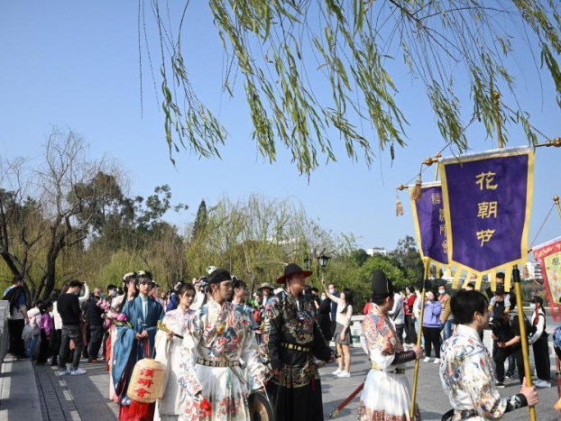People in traditional costumes celebrate traditional Flower Festival in Fujian