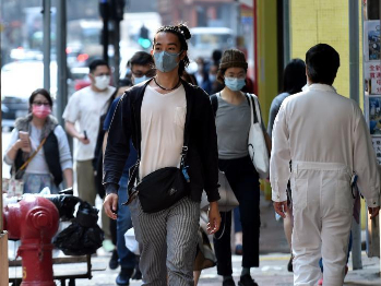 Hong Kong reports 18 new COVID-19 cases, vaccination program expanded