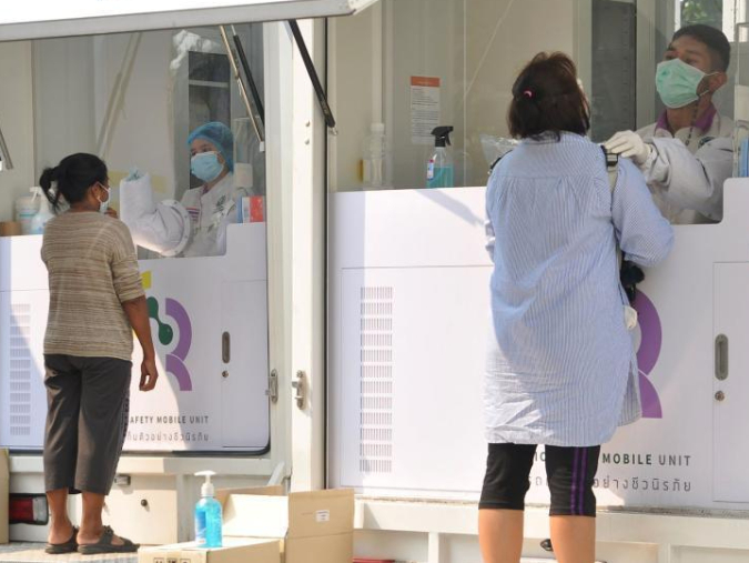 People take nucleic acid test for COVID-19 in Bangkok