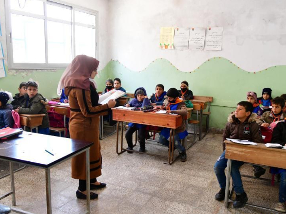 Syrian students attend class at school in Quneitra