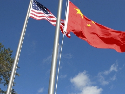 China shrugs off US sanctions over HK, set to insist on core stances in Alaska