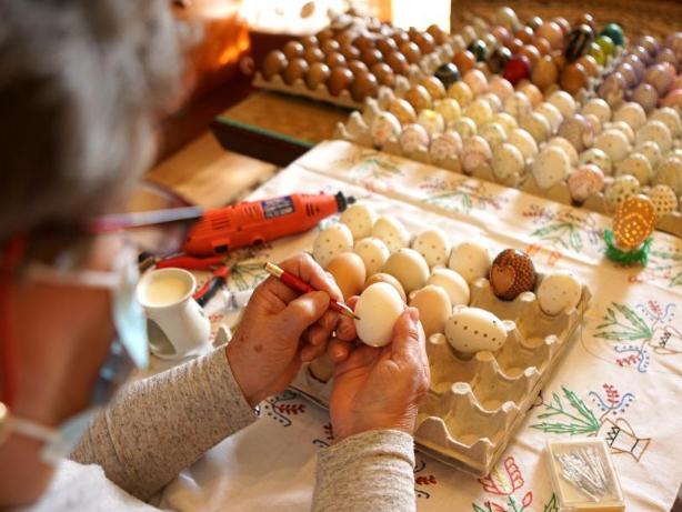 Women in countryside paint Easter eggs in Czech Republic