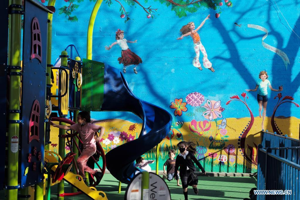 Children play at reopened amusement park in Burlingame city in north California