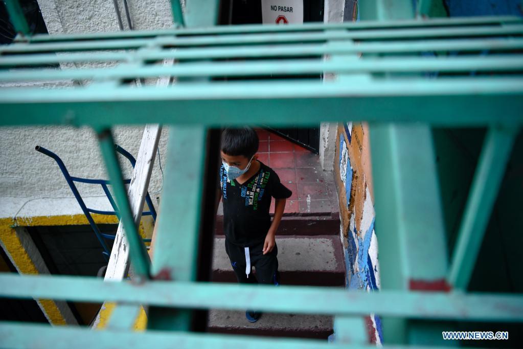 Migrants rest inside Casa Tochan in Mexico City