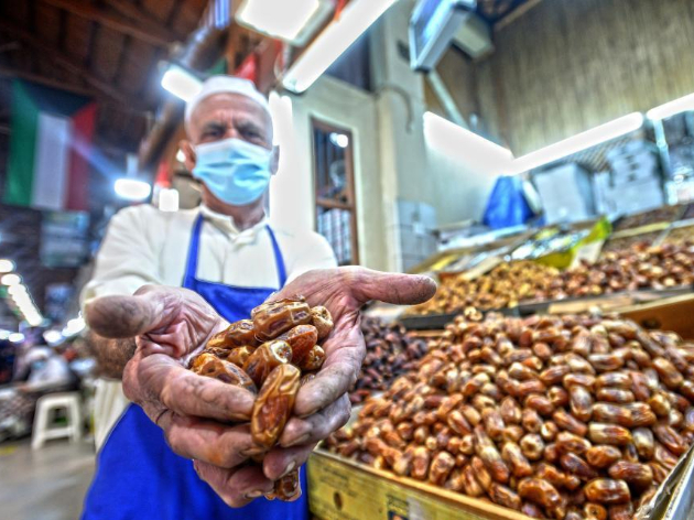 Vendor arranges dates for sale at Al-Mubarakiya market in Kuwait City