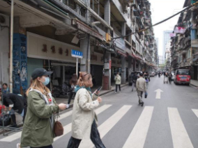 Wuhan bustling a year after lifting lockdown