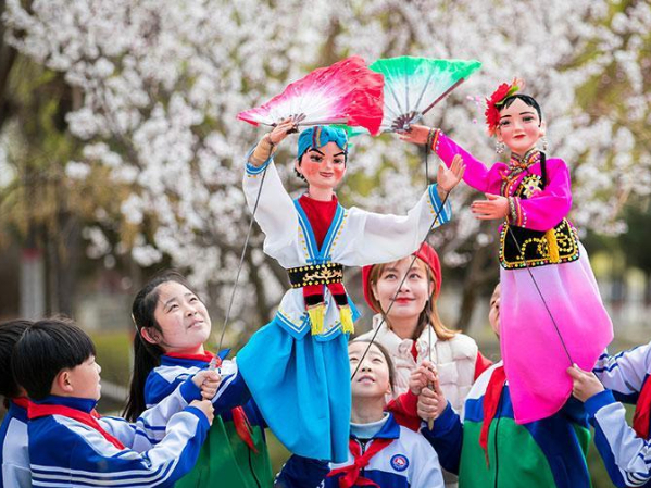 In pics: Pupils learn rod puppet skills in N China