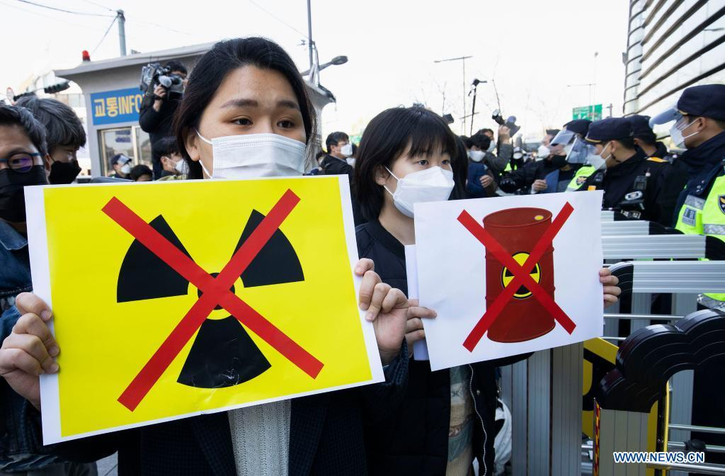 People protest against Japan's decision to dump radioactive water into sea in Seoul