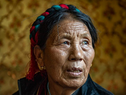 Former serf now enjoys happy life with family in Tibet