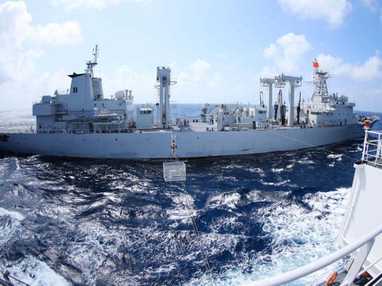 Navy vessels perform underway replenishment