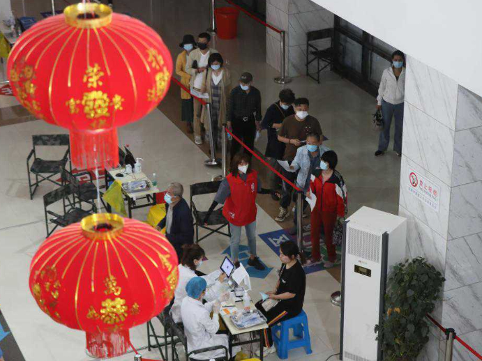 People get vaccinated with COVID-19 vaccines in Shenyang, Liaoning