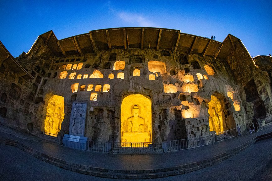 Grottoes in central China welcome vistors at dusk