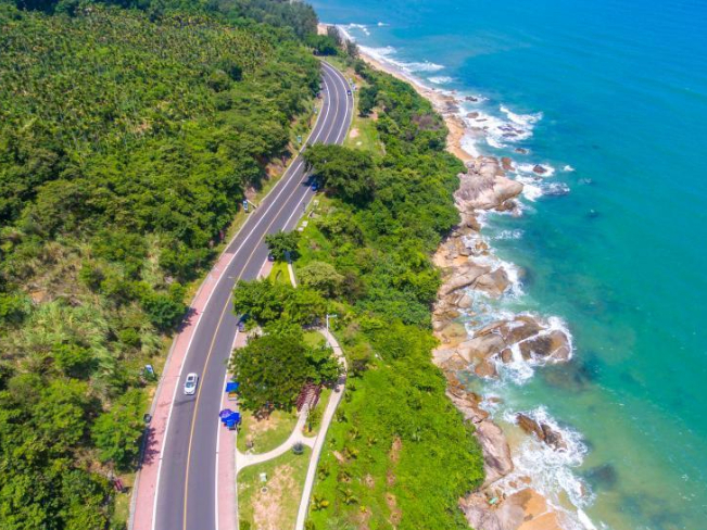 Aerial view of charming Wanning coastal tourist highway in Hainan Province