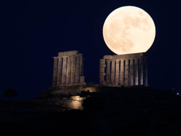 Full moon rises over Temple of Poseidon in Greece