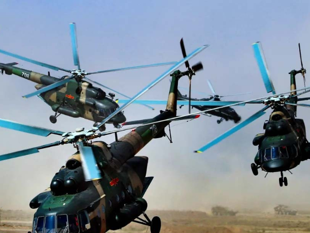 Attack helicopters in low-altitude defense penetration in ZAPAD/INTERACTION-2021 exercise