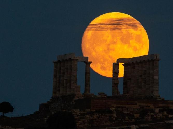 Full moon seen over Temple of Poseidon in Greece