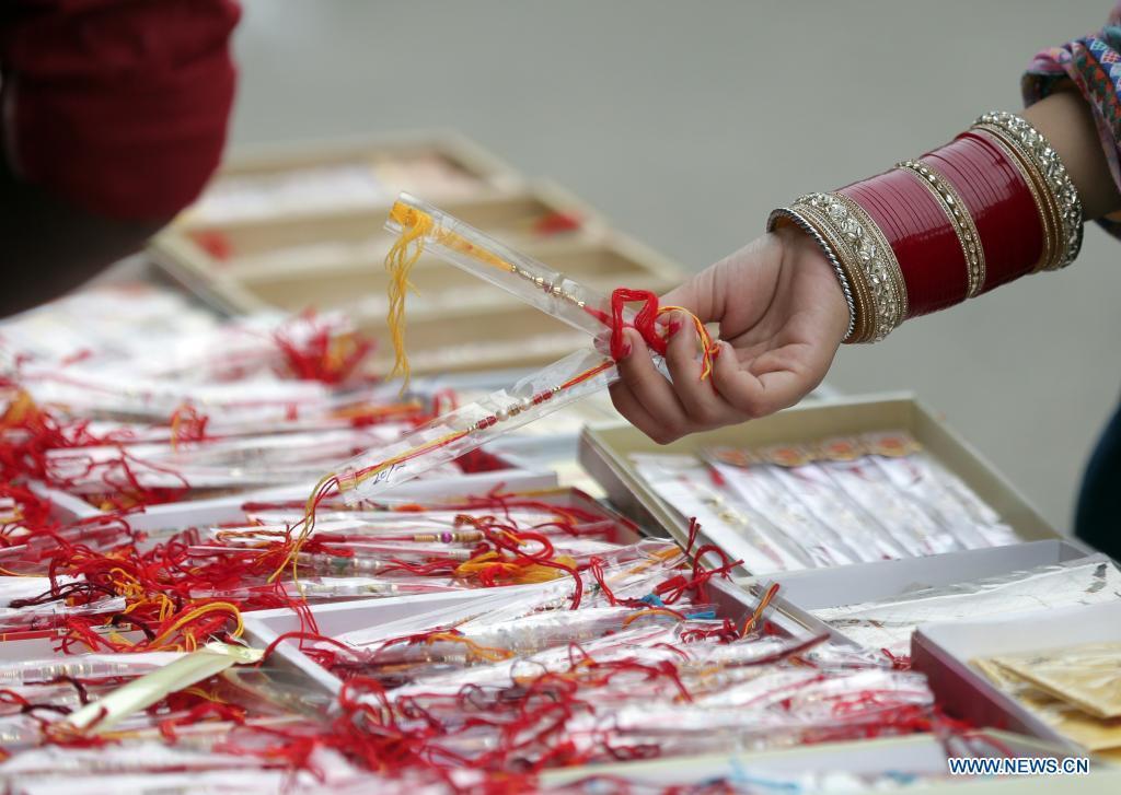 People prepare for Raksha Bandhan festival in India's Punjab