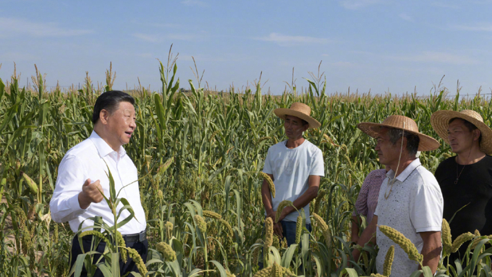 Xi chats with villagers in the fields in Shaanxi Province