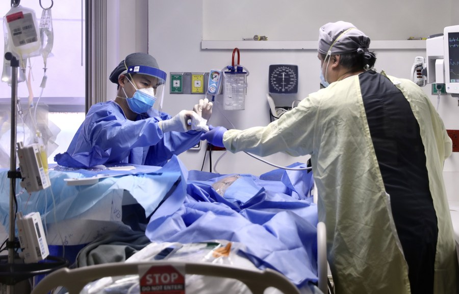 US to surpass 1918 pandemic death toll in less than 2 weeks: US media